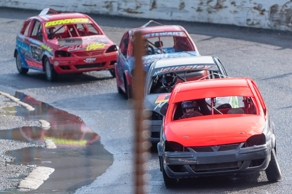 Taylor Borthwick Teenager Stock Car Racer racing in the lead around racing track