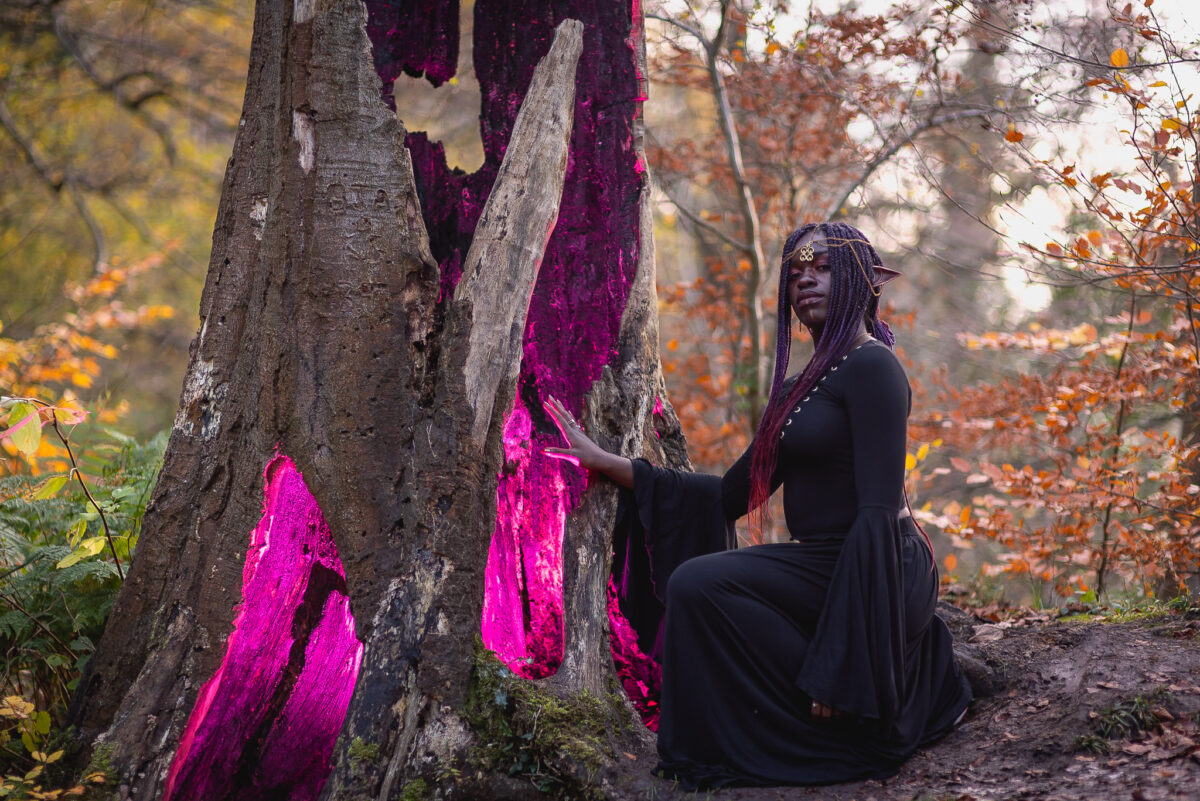 black fantasy elf woman lighting inside of a hollow tree purple, in Roslin Glen autumn forest