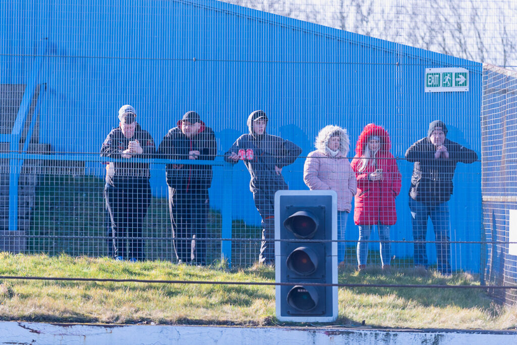Stock Car Racing spectators behind a fence